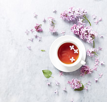 Cup Of Tea With Lilac Flowers ...