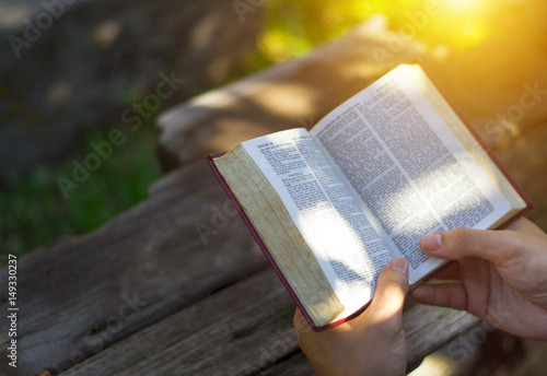 Fotografie, Obraz  Man reading from the holy bible, close up