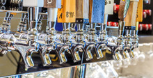 Micro Brew Or Draft Beer Taps: Row Of Draft Beer Taps At A Bar In Montgomery Alabama.