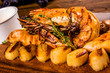 Grilled seafood with spices on wooden board