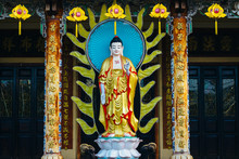 Standing Amitabha Buddha Statue On The Entrance To Quang Minh Mahayana Buddhism Temple In Da Nang, Vietnam
