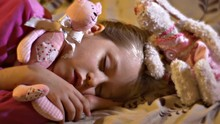 Little Girl Sweetly Sleep Hugging Her Favorite Toys, The Sweetest Dreams After The Game