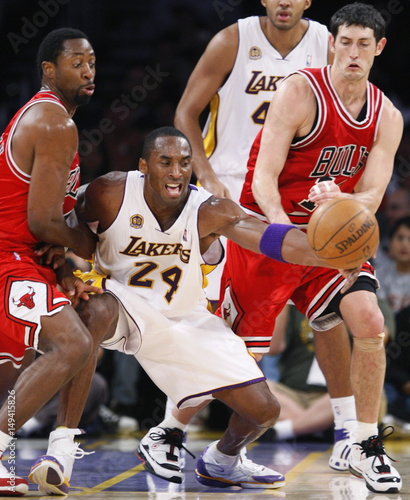quality design bb629 e8712 Los Angeles Lakers Kobe Bryant fights for a loose ball with ...