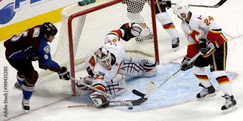 Calgary Flames Kiprusoff And Conroy Knock Away A Shot From Colorado