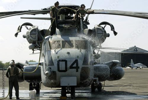 U S  SERVICEMEN WASH A SUPER STALLION HELICOPTER AT CLARK AIR BASE