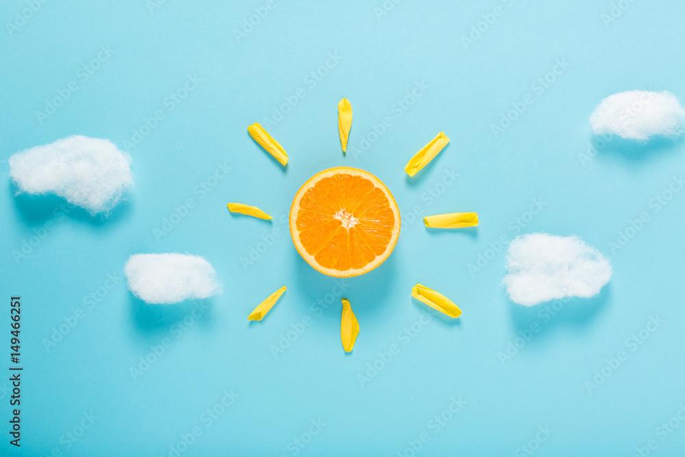 Fototapety, obrazy: Orange slice as the sun concept