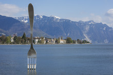 Vevey, Switzerland - April 5, 2016- Giant Steel Fork In Water Of Geneva Lake, Vevey, Switzerland.The Fork Went Up In 1995 To Mark The 10th Anniversary Of The Alimentarium, Veveys Food Museum Copy