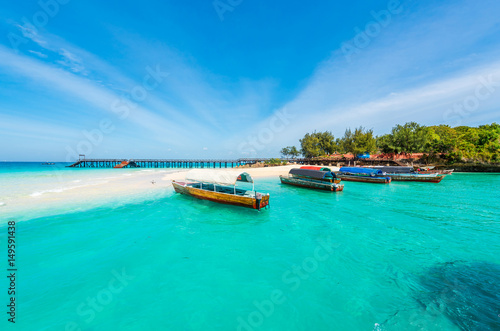 Zanzibar colorful exotic seascape with boats near Zanzibar shore in Africa
