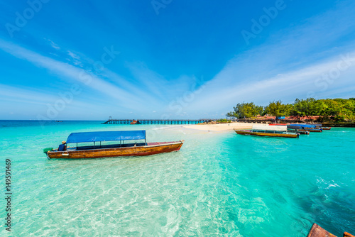 colorful exotic seascape with boats near Zanzibar shore in Africa
