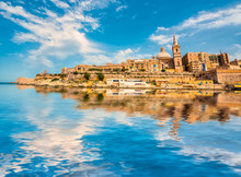 View On Valletta With Its Architecture From The Sea With Reflection