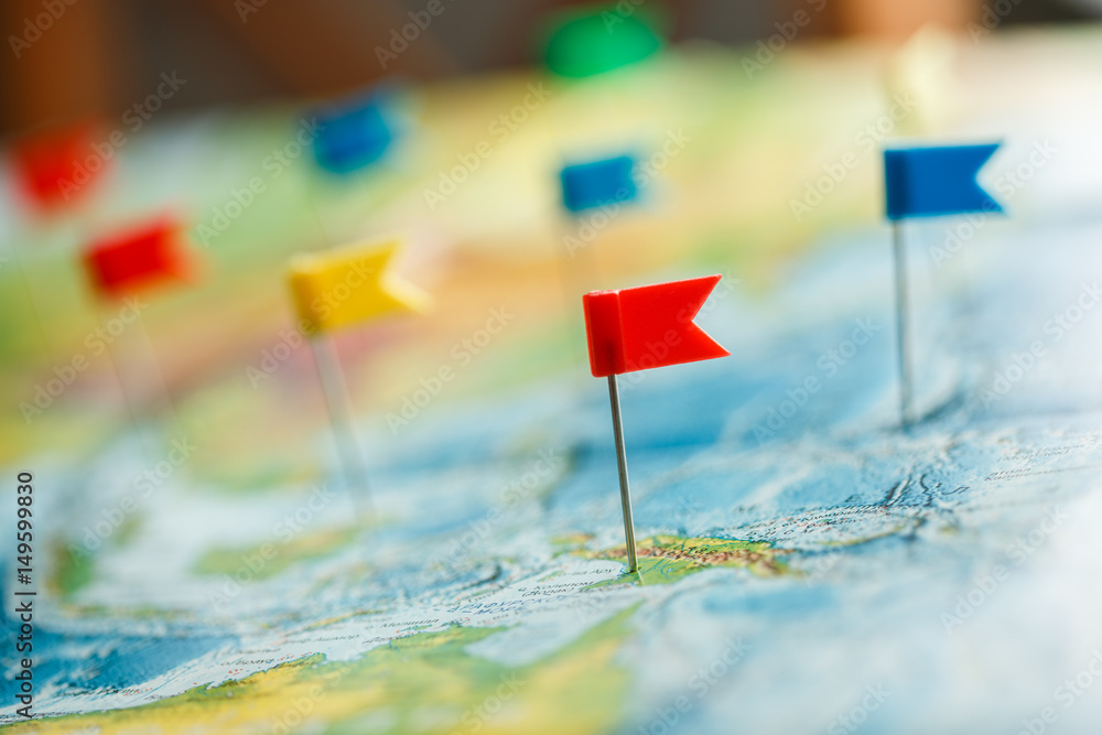Fototapety, obrazy: Travel concept with flag pushpins and world map
