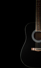 Classical Black Guitar On A Black Background