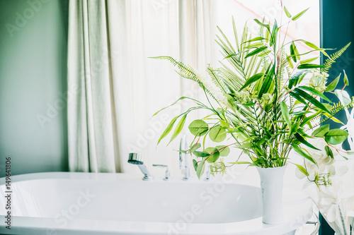 Green indoor plants in vase in bathroom , home interior concept