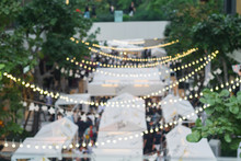 Blur Image Of Outdoor Market On Street Background With Bokeh .