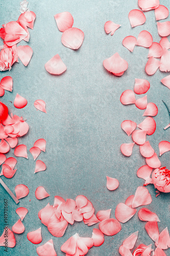 Pretty pink pastel petals of flowers on turquoise rustic background pretty pink pastel petals of flowers on turquoise rustic background flat lay top view mightylinksfo
