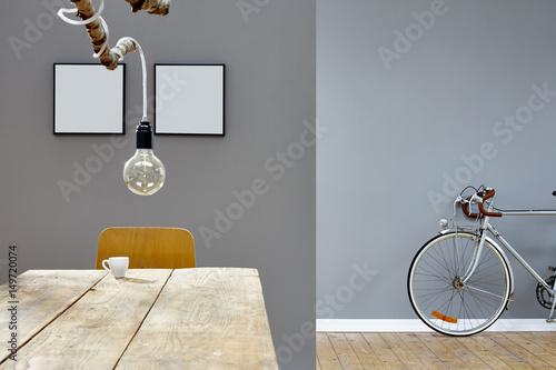 Fotobehang Fiets modern decoration in vintage loft branch lamp table and silver bike