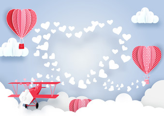 Fototapeta Niebo airplane flying over clouds and smoke hearts shape with Cute hot air balloons background. Paper art style