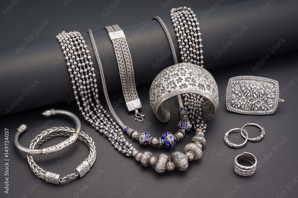 Fototapeta Collection of antique traditional silver jewelry on black paper