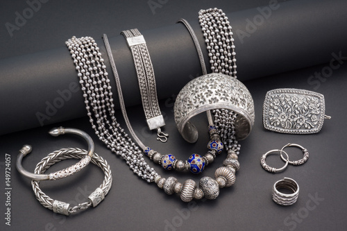 Collection of antique traditional silver jewelry on black paper