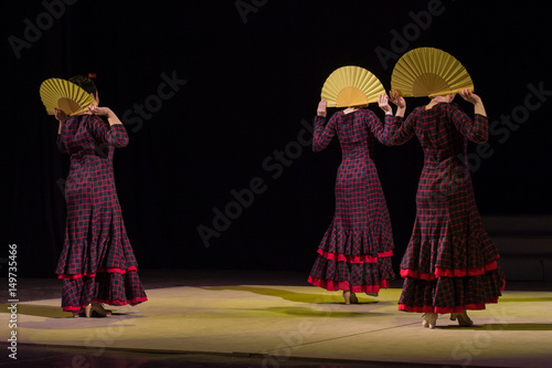 Recess Fitting Carnaval RUSSIA, RYAZAN - DECEMBER 11, 2016: V RUSSIAN FESTIVAL FLAMENCO. Three women in dresses in a cage with fans.