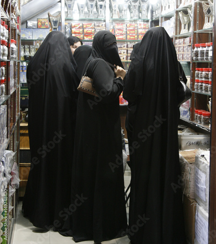 Veiled women shop at al-Zall souk in downtown Riyadh - Buy this