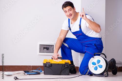 Cuadros en Lienzo Man doing electrical repairs at home