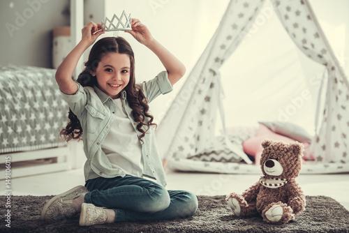 Valokuva  Beautiful schoolgirl at home