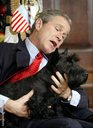 U S President George W Bush Holds Onto His Dog Barney After The
