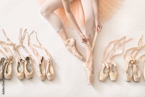 Fototapeta  Ballerina is dressing in studio