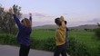 Group of three athletic runner warm-up and stretches before exercise and jogging in the mountains. Steadicam shot.