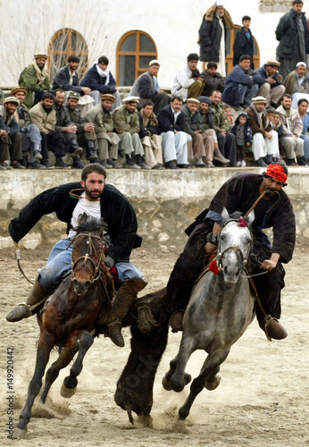 AFGHAN RIDERS BATTLE TO GRAB THE CARCASS OF GOAT DURING A GAME