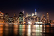 New York City Manhattan downtown skyline on night skyscrapers illuminated over Hudson River panorama