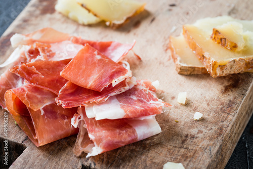 Fotografie, Obraz  Spanish ham jamon serrano or Italian prosciutto crudo and sliced Italian hard ch