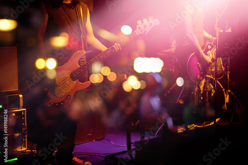 Fotografie, Obraz  Guitarist on stage for background, soft and blur concept