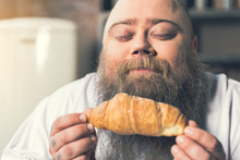 Man Smelling Pastry