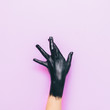 Leinwanddruck Bild - fashion pose by fingers on one arm which painted in black on a purple background. minimal style
