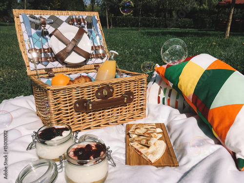 Keuken foto achterwand Picknick Picnic Basket Food On Blanket With Pillows And Soap Bubbles