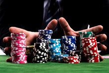 A Poker Player Hands Pushing I...