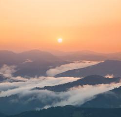 FototapetaMountain valley during sunrise. Natural summer landscape