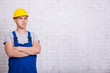portrait of builder in uniform and copy space over white wall