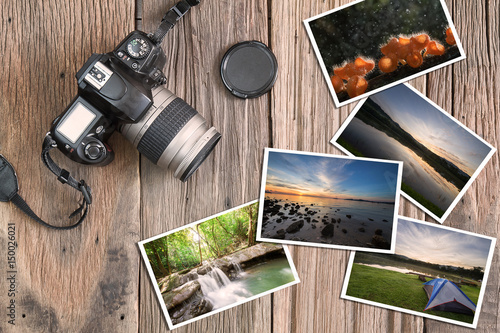 Olld grunge camera and photos on vintage grunge wooden background in vintage style