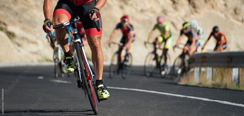 Fototapeta Cycling competition,cyclist athletes riding a race at high speed