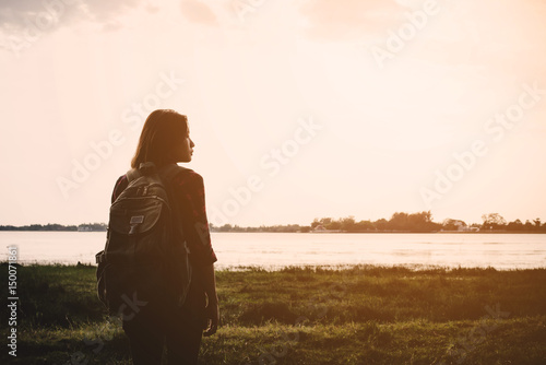 Fotografie, Obraz  Young woman standing look View of the lake.