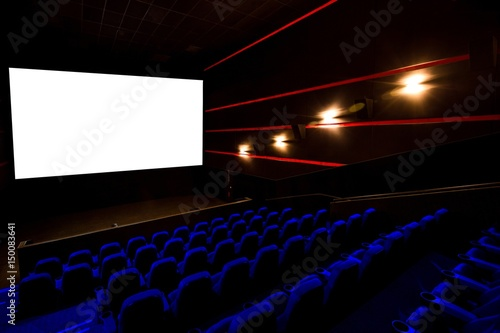Photo  Cinema hall, movie theater, theatre with blue armchairs and white screen with co