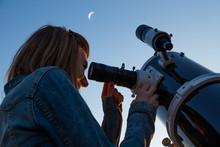 Girl Looking At The Moon Throu...