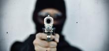 Criminal Robber With Aiming Gun, Bad Guy In Hood Holding Pistol Handgun.