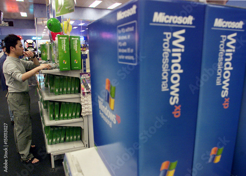 A visitor to a computer store in Sydney browses Windows XP Home
