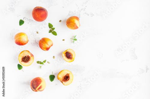 Keuken foto achterwand Vruchten Fresh peaches on white background. Summer peaches. Flat lay, top view, copy space