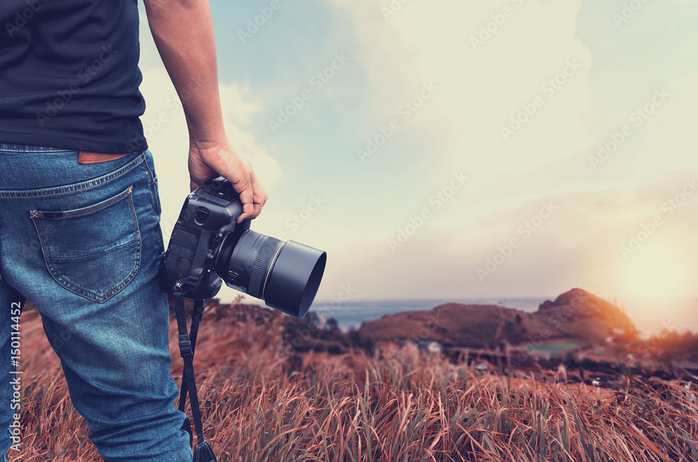 Fototapety, obrazy: Close-up shot of man  holding camera  standing on the hill