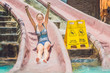 woman going down a water slide